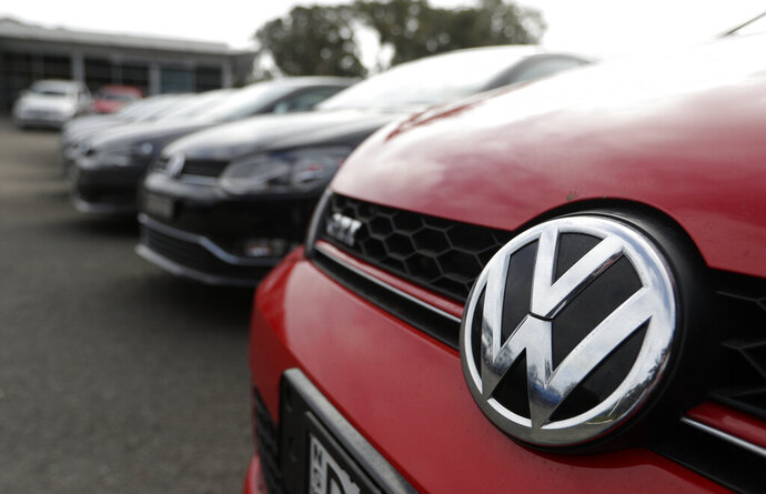 Display cars are parked at a Volkswagen dealership in Sydney, Monday, Sept. 16, 2019. Volkswagen has agreed to pay up to 127 million Australian dollars ($87 million) to settle an Australian class action stemming from the 2015 diesel emissions scandal, the German automaker and a lawyer said Monday. (AP Photo/Rick Rycroft)