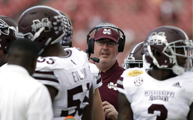 Mississippi State head coach Joe Moorhead stand among his players during the second half of the Outback Bowl NCAA college football game against Iowa Tuesday, Jan. 1, 2019, in Tampa, Fla. (AP Photo/Chris O'Meara)