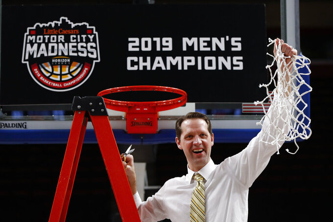 Northern Kentucky coach John Brannen holds up the net after the team's77-66 win against Wright State in an NCAA college basketball game for the Horizon League men's tournament championship in Detroit, Tuesday, March 12, 2019. (AP Photo/Paul Sancya)