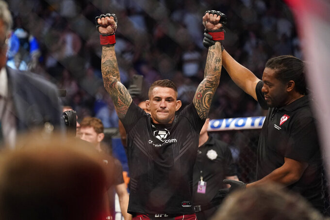 Dustin Poirier is declared the winner after Conor McGregor was injured during a UFC 264 lightweight mixed martial arts bout Saturday, July 10, 2021, in Las Vegas. (AP Photo/John Locher)