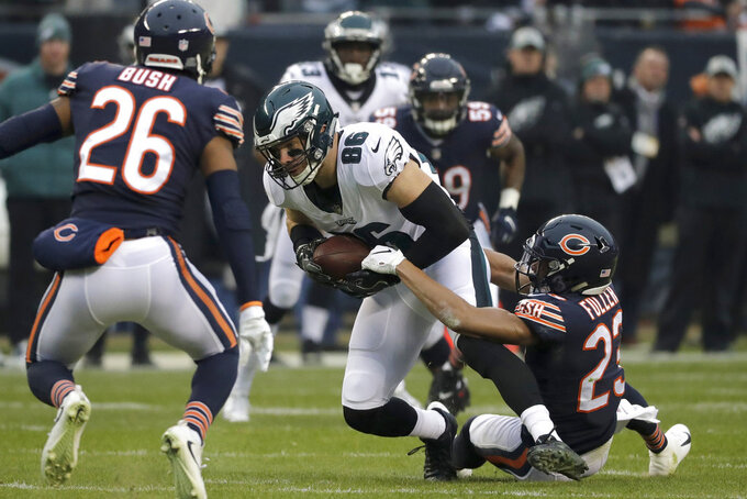 Chicago Bears cornerback Kyle Fuller (23) tackles Philadelphia Eagles tight end Zach Ertz (86) during the first half of an NFL wild-card playoff football game Sunday, Jan. 6, 2019, in Chicago. (AP Photo/Nam Y. Huh)