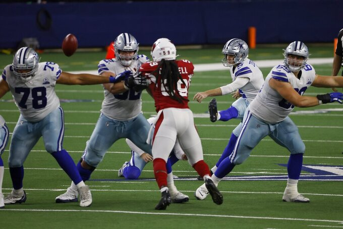 Arizona Cardinals' De'Vondre Campbell (59) rushes as Dallas Cowboys place kicker Greg Zuerlein (2) attempts a field goal in the second half of an NFL football game in Arlington, Texas, Monday, Oct. 19, 2020. The attempt was no good. (AP Photo/Ron Jenkins)