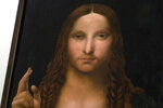 """A view of a copy of the """"Salvator Mundi"""" (Savior of the World), by Leonardo da Vinci, that was recovered and shown during a press conference at the police headquarters in Naples, Italy, Wednesday, Jan. 20, 2021. Italian police have recovered a copy of Leonardo da Vinci's 16th century """"Salvator Mundi"""" painting of Jesus Christ that was stolen from a Naples church without the priests even realizing it was gone. The discovery was made over the weekend when Naples police working on a bigger operation found the painting hidden in an apartment. Police chief Alfredo Fabbrocini said the owner offered a """"less than credible"""" explanation that he had """"casually"""" bought it at a small market. (AP Photo/Sicomunicazione)"""
