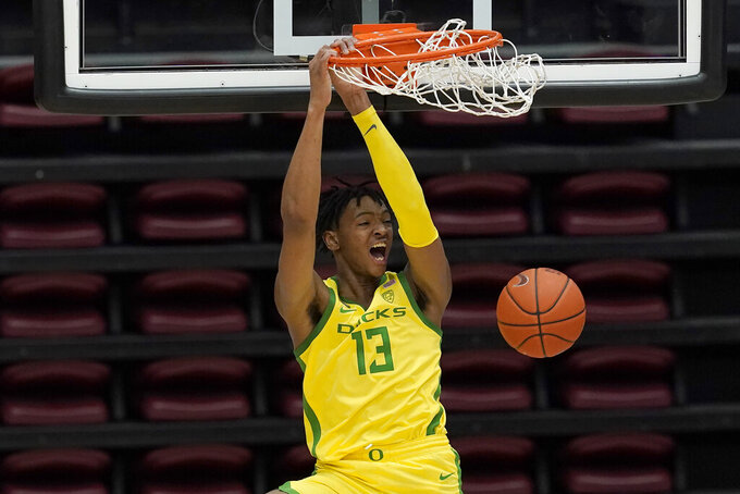 Oregon forward Chandler Lawson dunks against Stanford during the second half of an NCAA college basketball game in Stanford, Calif., Thursday, Feb. 25, 2021. (AP Photo/Jeff Chiu)