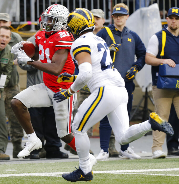 Ohio State receiver Parris Campbell, left, is run out of bounds by Michigan defensive back Tyree Kinnel during the second half of an NCAA college football game Saturday, Nov. 24, 2018, in Columbus, Ohio. Ohio State beat Michigan 62-39. (AP Photo/Jay LaPrete)