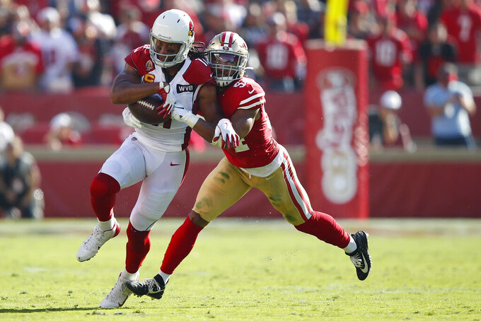 Arizona Cardinals wide receiver Larry Fitzgerald, left, runs against San Francisco 49ers middle linebacker Fred Warner during the first half of an NFL football game in Santa Clara, Calif., Sunday, Nov. 17, 2019. (AP Photo/John Hefti)