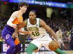 Boston Celtics' Al Horford (42) drives past Cleveland Cavaliers' Cedi Osman (16) in the first half of an NBA basketball game, Tuesday, March 26, 2019, in Cleveland. (AP Photo/Tony Dejak)