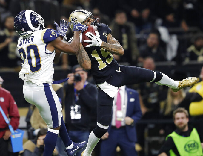 New Orleans Saints' Ted Ginn catches a pass in front of Los Angeles Rams' Lamarcus Joyner during the second half of the NFL football NFC championship game, Sunday, Jan. 20, 2019, in New Orleans. (AP Photo/John Bazemore)