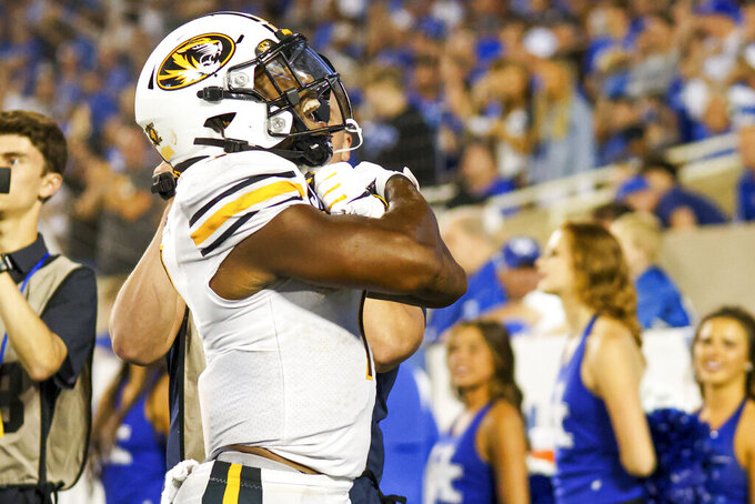Missouri running back Tyler Badie (1) celebrates his touchdown during the fourth quarter of the team's NCAA college football game against Kentucky in Lexington, Ky., Saturday, Sept. 11, 2021. (AP Photo/Michael Clubb)
