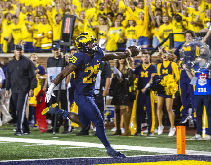 Michigan running back Hassan Haskins rushes for a touchdown during the fourth quarter of the team's NCAA college football game against Washington in Ann Arbor, Mich., Saturday, Sept. 11, 2021. (AP Photo/Tony Ding)