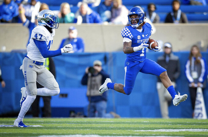 Kentucky wide receiver Lynn Bowden Jr. (1) runs a punt return past Middle Tennessee wide receiver Reginald Henderson (47) during the second half of an NCAA college football game against Kentucky in Lexington, Ky., Saturday, Nov. 17, 2018. (AP Photo/Bryan Woolston)
