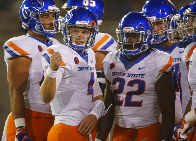 Boise State quarterback Brett Rypien, front left, gestures to the bench as running back Alexander Mattison waits for the call of a play in the huddle in the second half of an NCAA college football game against Air Force, Saturday, Oct. 27, 2018, at Air Force Academy, Colo. (AP Photo/David Zalubowski)