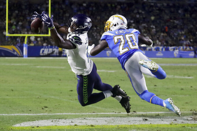 Los Angeles Chargers defensive back Desmond King, right, breaks up a pass intended for Seattle Seahawks wide receiver Gary Jennings during the second half of an NFL preseason football game Saturday, Aug. 24, 2019, in Carson, Calif. (AP Photo/Alex Gallardo)