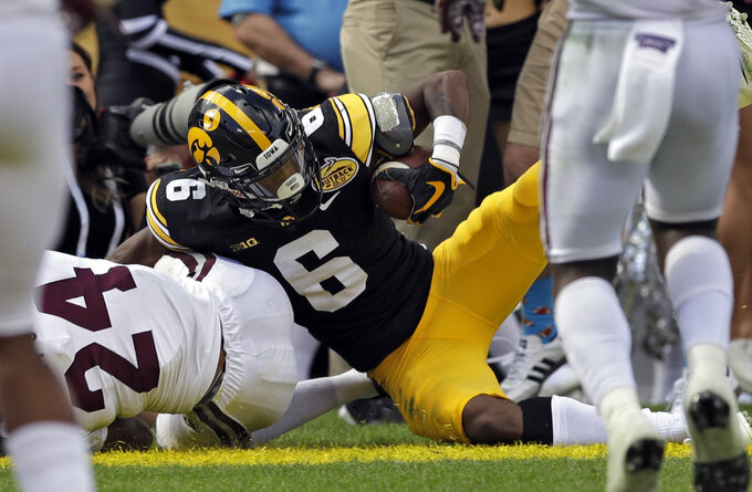 Iowa wide receiver Ihmir Smith-Marsette (6) scores on a 13-yard touchdown pass from quarterback Nate Stanley during the first half of the Outback Bowl NCAA college football game against Mississippi State, Tuesday, Jan. 1, 2019, in Tampa, Fla. (AP Photo/Chris O'Meara)