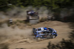 Jourdan Serderidis of Greece and his co driver Fred Miclotte of Belgium with their Ford Fiesta WRC car compete in the WRC Acropolis Rally at the stage of Aghii Theodori,, west of Athens, on Friday, Sept. 10, 2021.The World Rally Championship returned to Greece after an eight-year absence .(AP Photo/Petros Giannakouris)