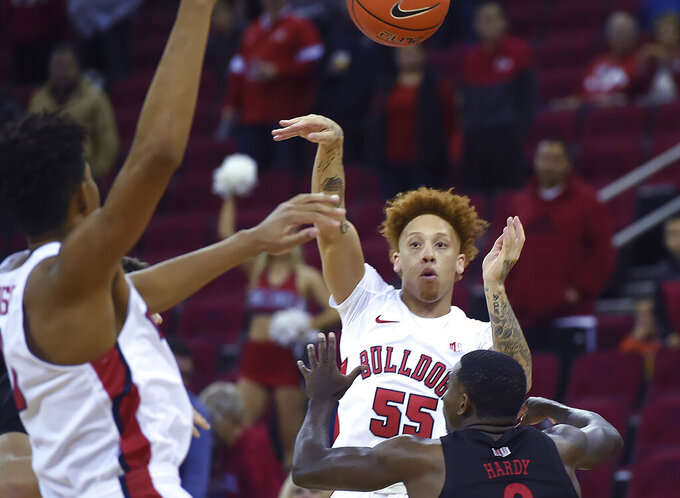 Fresno State's Noah Blackwell passes the ball over UNLV's Amauri Hardy during an NCAA college basketball game Wednesday, Dec. 4, 2019, in Fresno, Calif. (Eric Paul Zamora/The Fresno Bee via AP)