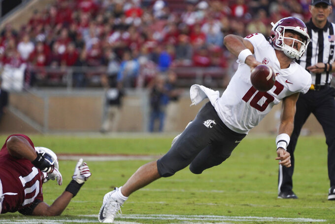 Stanford outside linebacker Jordan Fox applies pressure to Washington State quarterback Gardner Minshew II in the first half of an NCAA college football game on Saturday, Oct. 27, 2018, in Stanford, Calif. (AP Photo/Don Feria)
