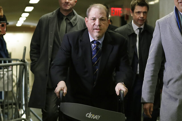 Harvey Weinstein arrives at court for his rape trial, in New York, Friday, Jan. 24, 2020. (AP Photo/Richard Drew)