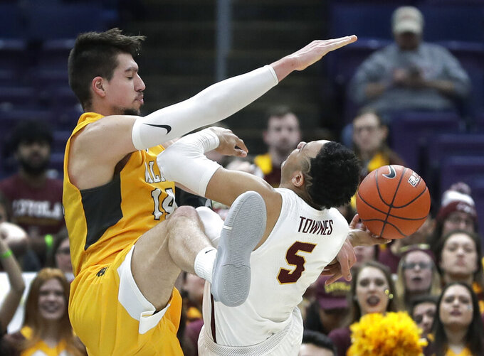 Loyola of Chicago's Marques Townes (5) is fouled on his way to the basket by Valparaiso's Jaume Sorolla during the second half of an NCAA college basketball game in the quarterfinal round of the Missouri Valley Conference tournament, Friday, March 8, 2019, in St. Louis. Loyola won 67-54. (AP Photo/Jeff Roberson)