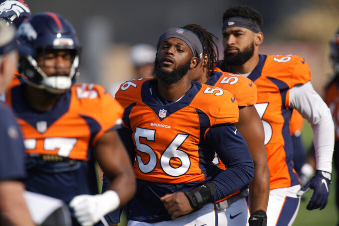 Denver Broncos linebacker Baron Browning takes part in drills during an NFL football training camp at the team's headquarters Tuesday, Aug. 17, 2021, in Englewood, Colo. (AP Photo/David Zalubowski)