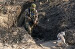 FILE- In this Nov. 2, 2019, file photo, a Ukrainian serviceman walks up from a trench at the new line of contact in Zolote, Luhansk region, eastern Ukraine. For new Ukrainian President Volodymyr Zelenskiy, a summit meeting with Russia, France and Germany marks a decisive moment in his push to end more than five years of fighting with Moscow-backed separatists in the eastern part of his country. (AP Photo/Evgeniy Maloletka, File)
