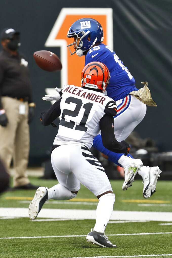 New York Giants wide receiver Golden Tate (15) catches a pass against Cincinnati Bengals cornerback Mackensie Alexander (21) during the second half of NFL football game, Sunday, Nov. 29, 2020, in Cincinnati. (AP Photo/Aaron Doster)