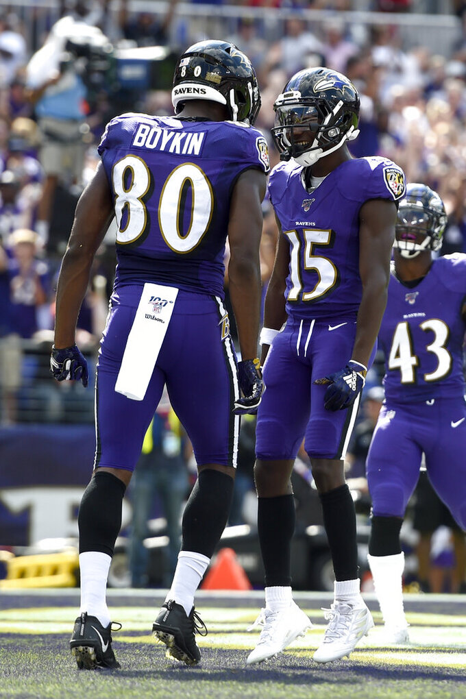Baltimore Ravens wide receiver Miles Boykin (80) celebrates his touchdown catch with wide receiver Marquise Brown (15) during the first half of an NFL football game against the Cleveland Browns Sunday, Sept. 29, 2019, in Baltimore. (AP Photo/Gail Burton)
