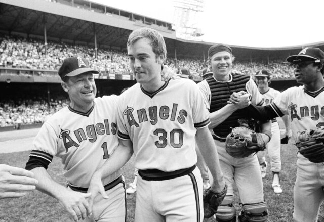 FILE - In this July 15, 1973, file photo, California Angels pitcher Nolan Ryan, 26, is congratulated by Angels manager Bobby Winkles after his no-hitter against the Detroit Tigers in Detroit. Catcher Art Kusnyer is at center right. The Angels won 6-0. Winkles, the former baseball coach who won three national championships at Arizona State and went on to manage in the majors, has died. He was 90. Arizona State said Winkles died Friday, April 17, 2020, with family and friends by his side. (AP Photo/Richard Sheinwald)