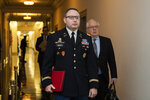 National Security Council aide Lt. Col. Alexander Vindman, walks to the hearing room to testify before the House Intelligence Committee on Capitol Hill in Washington, Tuesday, Nov. 19, 2019, during a public impeachment hearing of President Donald Trump's efforts to tie U.S. aid for Ukraine to investigations of his political opponents. (AP Photo/Manuel Balce Ceneta) arrives to testify to the House Intelligence Committee, Tuesday, Nov. 19, 2019. (AP Photo/Manuel Balce Ceneta)