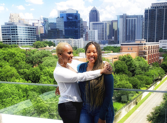 This May 14, 2019 photo released by The Decarceration Collective shows lead counsel MiAngel Cody, left, and attorney Brittany K. Barnett in Dallas, Texas.  Barnett and Cody are warrior attorneys with a mission: Freeing nonviolent drug offenders serving life in a federal system they're working to reform. (Dessie Brown Jr./The Decarceration Collective via AP)