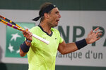 Spain's Rafael Nadal reacts. As he plays Serbia's Novak Djokovic rduring their semifinal match of the French Open tennis tournament at the Roland Garros stadium Friday, June 11, 2021 in Paris. (AP Photo/Michel Euler)
