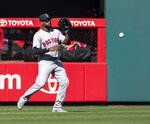 Boston Red Sox center fielder Jackie Bradley Jr. chases a single by Philadelphia Phillies' Rhys Hoskins during the eighth inning of a baseball game Sunday, Sept. 15, 2019, in Philadelphia. (AP Photo/Laurence Kesterson)