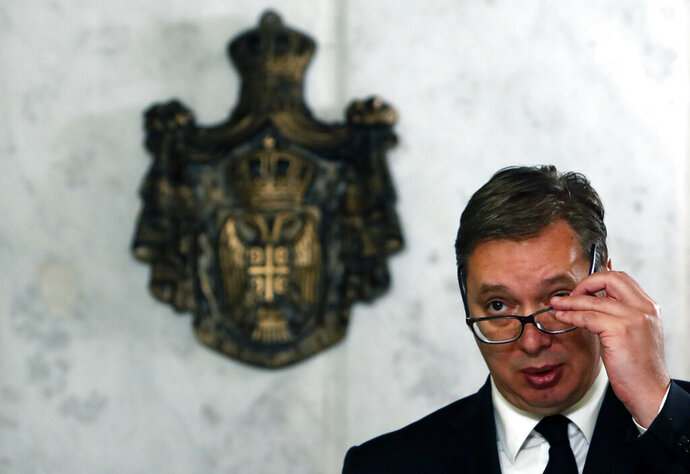 Serbian President Aleksandar Vucic speaks during a press conference after talks with European Union envoy for the negotiations Miroslav Lajcak in Belgrade, Serbia, Thursday, Oct. 15, 2020. The EU has mediated the talks between Belgrade and Pristina, the two former wartime foes for more than a decade. (AP Photo/Darko Vojinovic)