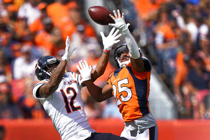 Denver Broncos cornerback Chris Harris (25) breaks up a pass intended for Chicago Bears wide receiver Allen Robinson (12) during the first half of an NFL football game, Sunday, Sept. 15, 2019, in Denver. (AP Photo/Jack Dempsey)