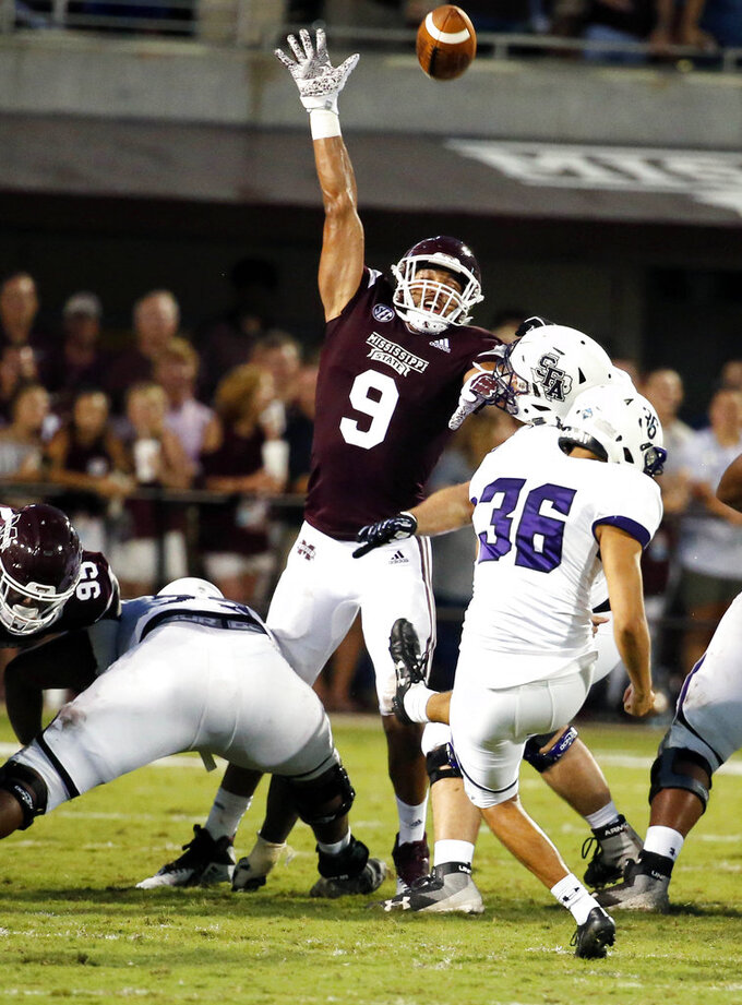 Stephen F. Austin place kicker Storm Ruiz (36) kicks a 36-yard field goal past the outstretched arms of Mississippi State defensive end Montez Sweat (9) during the first half of their NCAA college football game, Saturday, Sept. 1, 2018, in Starkville, Miss. (AP Photo/Rogelio V. Solis)