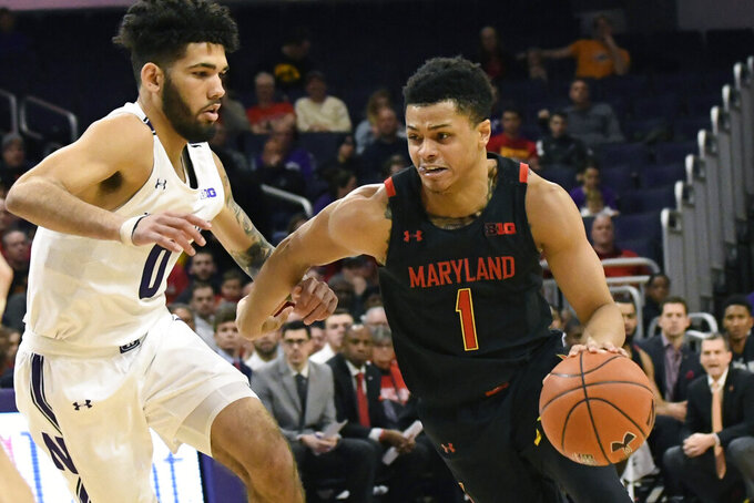 Maryland guard Anthony Cowan Jr. (1) is defended by Northwestern guard Boo Buie (0) during the first half of an NCAA college basketball game, Tuesday, Jan. 21, 2020, in Evanston, Ill. (AP Photo/David Banks)