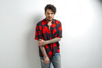 """This Sept. 6, 2019 photo shows singer Adam Lambert posing for a portrait in New York to promote """"Velvet: Side A,"""" one-half of his first studio album in four years. (Photo by Scott Gries/Invision/AP)"""