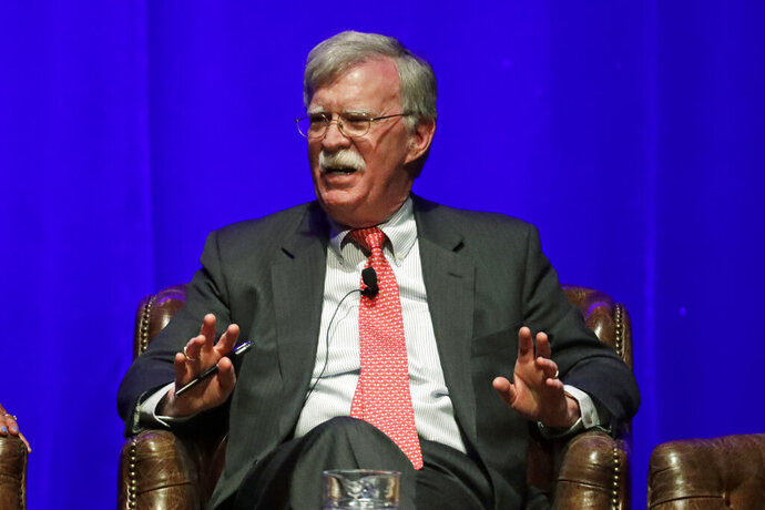 FILE - In this Feb. 19, 2020, file photo, former national security adviser John Bolton takes part in a discussion on global leadership at Vanderbilt University in Nashville, Tenn. An attorney for Bolton said Wednesday, June 10, that President Donald Trump is trying to put on ice publication of the former top administration official's forthcoming memoir after White House lawyers again this week raised concerns that the book contains classified material that presents a national security threat. (AP Photo/Mark Humphrey, File)