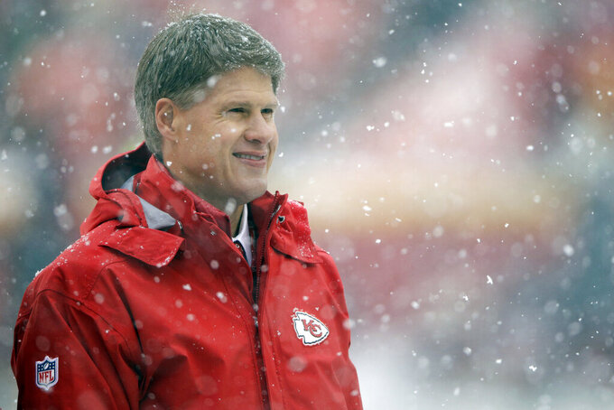 FILE - Clark Hunt, chairman and CEO of the Kansas City Chiefs, follows warmups before an NFL football game against the Denver Broncos, Sunday, Dec. 15, 2019,  in Kansas City, Mo. Lamar Hunt was a champion of Black rights during the Civil Rights era of the 1960s. He grew up in conservative circles yet formed his own opinions of right and wrong. And when his football-loving son was born in 1965, those principles that Hunt instilled in his football franchise became instilled in Clark, who years later would succeed him as chairman of the Chiefs. (AP Photo/Charlie Riedel, File)