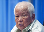 In this photo released by the Extraordinary Chambers in the Courts of Cambodia, Khieu Samphan, former Khmer Rouge head of state, looks on as he sits in a courtroom during a hearing at the U.N.-backed war crimes tribunal in Phnom Penh, Cambodia, Thursday, Aug. 19, 2021. The last living member of former Cambodian leader Pol Pot's inner circle denied complicity in the genocide committed under the brutal Khmer Rouge government, telling an international tribunal hearing his appeal Thursday that he was being judged as a proxy for the entire radical communist regime. (Mark Peters/Extraordinary Chambers in the Courts of Cambodia via AP)