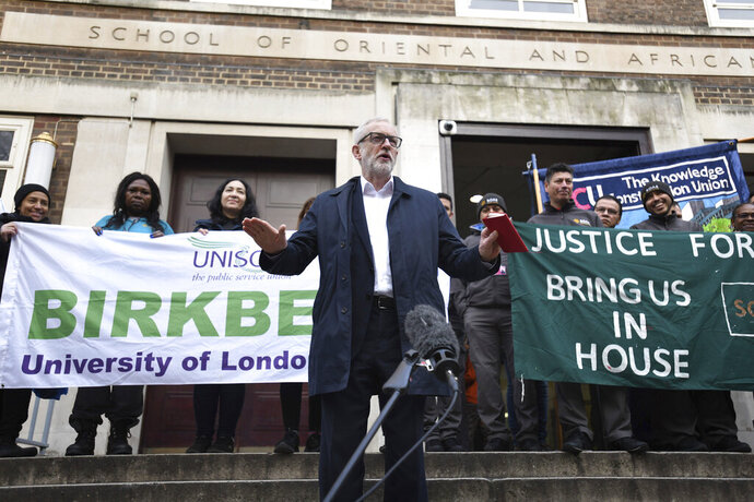 Labour leader Jeremy Corbyn speaks outside Birkbeck/SOAS University of London, as he announces his party's plan for the extension of workers' rights, whilst on the General Election campaign trail, in London, Tuesday,  Dec.3, 2019. Britain goes to the polls on Dec. 12. (David Mirzoeff/PA via AP)