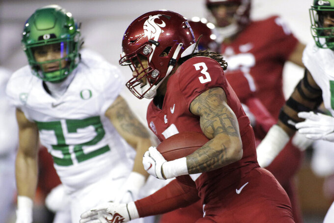 Washington State running back Deon McIntosh (3) carries the ball during the first half of the team's NCAA college football game against Oregon in Pullman, Wash., Saturday, Nov. 14, 2020. (AP Photo/Young Kwak)
