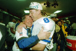 FILE - In this Jan. 30, 1994, file photo, Dallas Cowboys' head coach Jimmy Johnson hugs quarterback Troy Aikman in their locker room after defeating the Buffalo Bills 30-13 in Super Bowl XXVIII at the Georgia Dome in Atlanta. There's plenty of room for debate over the best first-round pick in the history of the Dallas Cowboys. (AP Photo/Charles Krupa, File)