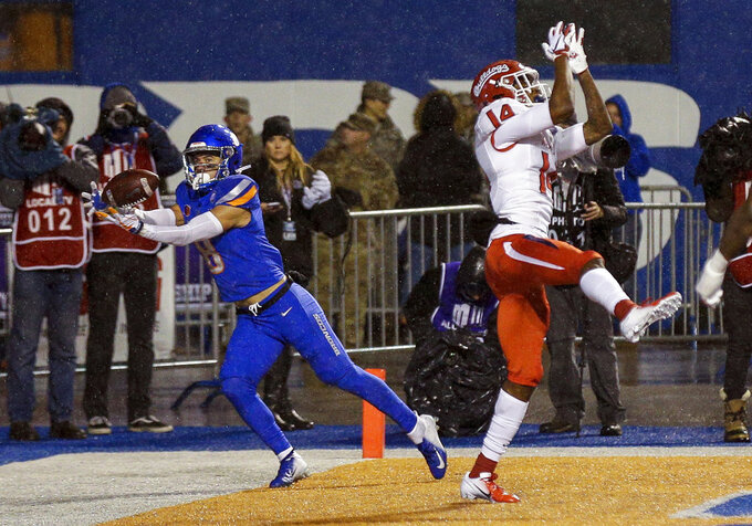 Boise State wide receiver Sean Modster (8) catches a touchdown pass that went through the hands of Fresno State defensive back Jaron Bryant (14) during the first half of an NCAA college football game for the Mountain West championship, Saturday, Dec. 1, 2018, in Boise, Idaho. (AP Photo/Steve Conner)