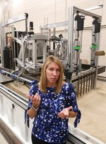 Heather Oravec, research associate professor stationed at the NASA Glenn Research Center talks about her work with extraterrestrial soil mechanics and extraterrestrial surface mobility in Cleveland on Sept. 9, 2019. Oravec's research helps in developing new tires for off world vehicles and rovers. (Mike Cardew/Akron Beacon Journal via AP)