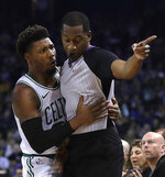 Boston Celtics' Marcus Smart, left, embraces referee Mitchell Ervin during the first half of the team's NBA basketball game against the Golden State Warriors on tuesday, March 5, 2019, in Oakland, Calif. (AP Photo/Ben Margot)
