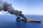 FILE - In this June 13, 2019 file photo, an oil tanker is on fire in the Gulf of Oman. The U.S. Navy is trying to put together a new coalition of nations to counter what it sees as a renewed maritime threat from Iran. Meanwhile, Iran finds itself backed into a corner and ready for a possible conflict. It stands poised on Friday, Sept. 6, 2019, to further break the terms of its 2015 nuclear deal with world powers. (AP Photo/ISNA, File)