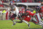 Mississippi defensive backs Jon Haynes (5) and Jalen Julius (26) tackle Texas A&M quarterback Kellen Mond (11) during the first half of an NCAA college football game in Oxford, Miss., Saturday, Oct. 19, 2019. (AP Photo/Thomas Graning)