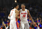 Florida guard sTre Mann (1) and Noah Locke (10) celebrate after Marshall called a timeout during the second half of an NCAA college basketball game Friday, Nov. 29, 2019, in Gainesville, Fla. (AP Photo/Matt Stamey)