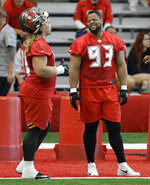 Tampa Bay Buccaneers nose tackle Ndamukong Suh (93) talks to defensive tackle Beau Allen (91) before the start of an NFL football minicamp Tuesday, June 4, 2019, in Tampa, Fla. (AP Photo/Chris O'Meara)